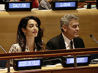 United States actor George Clooney (R) and wife Amal Clooney attend a Leaders Summit for Refugees during the United Nations 71st session of the General Debate at the United Nations General Assembly at United Nations headquarters in New York, New York, USA, 20 September 2016. Photo Credit: Peter Foley/CNP/AdMedia