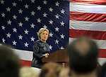 Hillary Clinton makes a point during her speech at the carpenter's training center in Affton.