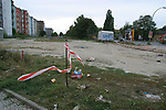 Derelict land where the former Cold War barrier split the city in two from 1961 until the Wall was opened 15 years ago on 9th November 1989. This section is in Bernauer Strasse, to the north of the city centre, the houses on the left being in the former GDR (East Germany).