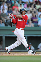 Yoan Moncada (24) of the Greenville Drive bats in a game against the Rome Braves on Friday, June 12, 2015, at Fluor Field at the West End in Greenville, South Carolina. (Tom Priddy/Four Seam Images)
