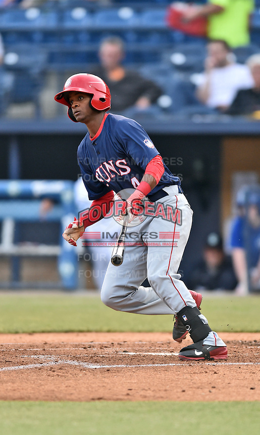 Hagerstown Suns shortstop Edwin Lora (4) swings at a pitch during a game against the Asheville Tourists at McCormick Field on April 27, 2016 in Asheville, North Carolina. The Tourists defeated the Suns 14-7. (Tony Farlow/Four Seam Images)