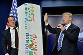 United States President Donald Trump speaks during a CEO town hall on the American business climate in the South Court Auditorium of the White House in Washington, DC, April 4, 2017.  Holding the chart is DJ Gribbin.<br /> Credit: Olivier Douliery / Pool via CNP
