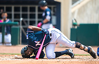 NWA Democrat-Gazette/CHARLIE KAIJO Northwest Arkansas Naturals right fielder Elier Hernandez (21) writhes in pain after getting tagged during a baseball game, Sunday, May 13, 2018 at Arvest Ballpark in Springdale.