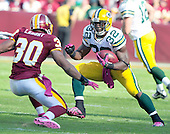 Green Bay Packers running back Brandon Jackson tries to elude Washington Redskins safety LaRon Landry (30) in fourth quarter action at FedEx Field in Landover, Maryland on Sunday, October 10, 2010.  The Redskins won the game in overtime 16 - 13..Credit: Ron Sachs / CNP