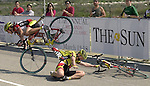 (3-14-01) Team Saturn members Lyne Bessette, left, and Ina Teutenberg, right, collide at the finish line of Wednesday's Stage 2 of the Redlands Bicycle Classic.  SAN BERNARDINO SUN STAFF PHOTO BY Rodrigo Peña.