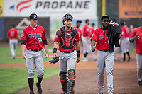James Marinan (58), Pabel Manzanero (47) and Luis Alecis (56), of the Billings Mustangs, walk towards the dugout before a Pioneer League game against the Ogden Raptors at Lindquist Field on August 17, 2018 in Ogden, Utah. The Billings Mustangs defeated the Ogden Raptors by a score of 6-3. (Zachary Lucy/Four Seam Images)