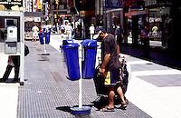 A beggar is searching for garbage in the shopping street Florida.<br /> 21.10.2000, Buenos Aires<br /> Copyright: Christian-Ditsch.de<br /> [Inhaltsveraendernde Manipulation des Fotos nur nach ausdruecklicher Genehmigung des Fotografen. Vereinbarungen ueber Abtretung von Persoenlichkeitsrechten/Model Release der abgebildeten Person/Personen liegen nicht vor. NO MODEL RELEASE! Nur fuer Redaktionelle Zwecke. Don't publish without copyright Christian-Ditsch.de, Veroeffentlichung nur mit Fotografennennung, sowie gegen Honorar, MwSt. und Beleg. Konto: I N G - D i B a, IBAN DE58500105175400192269, BIC INGDDEFFXXX, Kontakt: post@christian-ditsch.de<br /> Urhebervermerk wird gemaess Paragraph 13 UHG verlangt.]