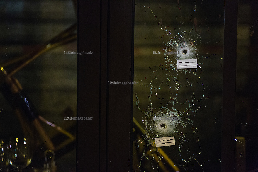 Paris, France, 15.11.2015. Bullet holes are seen in winwos of one of the many restaurants and cafes that were struck by the attack. Images from Paris in the aftermath of the devastating terror attacks on friday november 13. Photo: Christopher Olssøn.