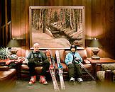 USA, Utah, senior man and woman sitting in ski gear at Alta's Rustler Lodge