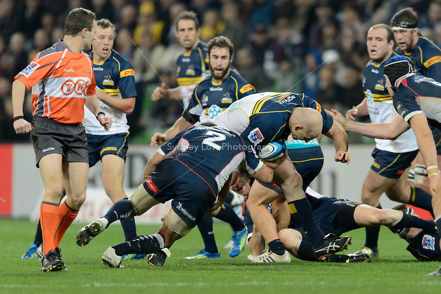 MELBOURNE, AUSTRALIA - JUNE 01: Stephen Moore of the Brumbies is tackled during round 15 of the Super Rugby match between the RaboDirect Rebels and the Brumbies at AAMI Park in Melbourne, Australia. Photo Sydney Low. Please contact ZUMA Press zumapress.com for editorial licensing.