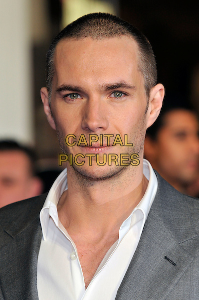 James D'Arcy.W.E. Uk film premiere at Odeon cinema, Kensington, London, England..11th January 2011.half length grey gray suit white stubble facial hair .CAP/PL.©Phil Loftus/Capital Pictures.
