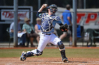 Maine Black Bears catcher Patrick Coughlin (26) during a game against the South Dakota State JackRabbits at South County Regional Park on March 9, 2014 in Port Charlotte, Florida.  Maine defeated South Dakota 5-4.  (Mike Janes/Four Seam Images)