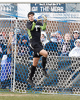 University of New Mexico goalkeeper Victor Rodriguez (1) collects high cross..NCAA Tournament. With a goal in the second overtime, University of Connecticut (white) defeated University of New Mexico (red), 2-1, at Morrone Stadium at University of Connecticut on November 25, 2012.