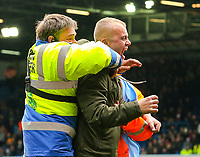 Steward wrestle a fan off the pitch after Leeds United equalised<br /> <br /> Photographer Alex Dodd/CameraSport<br /> <br /> The EFL Sky Bet Championship - Leeds United v Brentford - Saturday 6th October 2018 - Elland Road - Leeds<br /> <br /> World Copyright &copy; 2018 CameraSport. All rights reserved. 43 Linden Ave. Countesthorpe. Leicester. England. LE8 5PG - Tel: +44 (0) 116 277 4147 - admin@camerasport.com - www.camerasport.com
