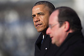 United States President Barack Obama, left, pauses while speaking during an arrival ceremony with President Francois Hollande of France on the South Lawn of the White House in Washington, D.C., U.S., on Tuesday, Feb. 11, 2014. <br /> Credit: Andrew Harrer / Pool via CNP