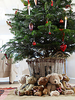 The children's old teddy bears have been placed around the base of the Christmas tree