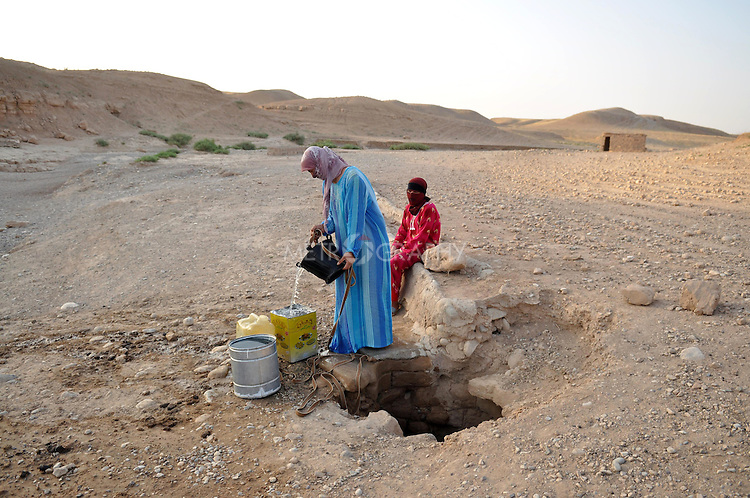 DOWDA, IRAQ:  Two women collect non-potable water from a local well.  This water will be used for washing.  Drinking water is over an hour away...Iraqi forces decimated the Dowda area in Germian during the 1988 Anfal genocidal campaign against the Kurds.  Daily life continues is this extremely harsh part of Iraq...Photo by Aram Karim/Metrography