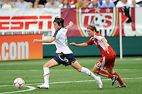 Megan Rapinoe (15) of the United States (USA) is chased by Chelsea Stewart (21) of Canada (CAN). The United States (USA) Women's National Team defeated Canada (CAN) 1-0 during an international friendly at Marina Auto Stadium in Rochester, NY, on July 19, 2009.
