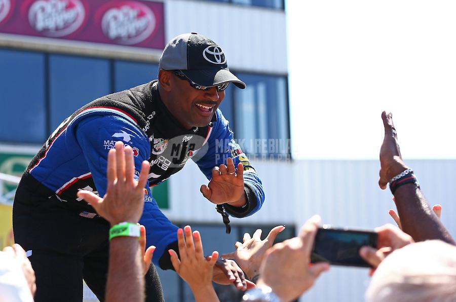 Jun. 2, 2013; Englishtown, NJ, USA: NHRA top fuel dragster driver Antron Brown during the Summer Nationals at Raceway Park. Mandatory Credit: Mark J. Rebilas-