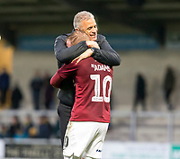 5th January 2020; Pirelli Stadium, Burton Upon Trent, Staffordshire, England; English FA Cup Football, Burton Albion versus Northampton Town; Manager of Northampton Town Keith Curle  hugs Nicholas Adams after the final whistle and wining the match 2-4 - Strictly Editorial Use Only. No use with unauthorized audio, video, data, fixture lists, club/league logos or 'live' services. Online in-match use limited to 120 images, no video emulation. No use in betting, games or single club/league/player publications