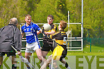 Fionn Fitzgerald and David O'Leary try to keep the ball in play for Dr Crokes under pressure from MFR and the watchful eye of Brendan Twiss Mike Francie Russell Laune Rangers during their Club Championship semi final in Killarney on Sunday