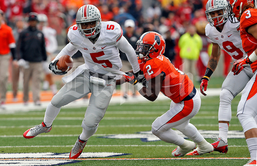 Ohio State Buckeyes quarterback Braxton Miller (5) carries the ball after almost tackled by Illinois Fighting Illini defensive back V'Angelo Bentley (2) in the second  quarter of their game at Memorial Stadium in Champaign, Ill on November 16, 2013. (Columbus Dispatch photo by Brooke LaValley)