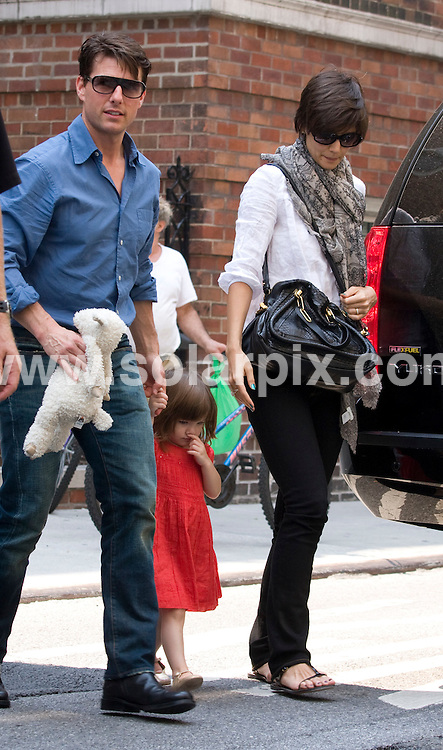 **ALL ROUND PICTURES FROM SOLARPIX.COM**.**SYNDICATION RIGHTS FOR UK, SPAIN, PORTUGAL, AUSTRALIA, S.AFRICA & DUBAI (U.A.E) ONLY**.Tom Cruise, Katie Holmes and Suri Cruise in Manhattan on August 15, 2008..This pic: Tom Cruise, Suri and Katie Holmes..JOB REF: 7042 PHZ/Mayer   DATE: 15_08_2008.**MUST CREDIT SOLARPIX.COM OR DOUBLE FEE WILL BE CHARGED* *UNDER NO CIRCUMSTANCES IS THIS IMAGE TO BE REPRODUCED FOR ANY ONLINE EDITION WITHOUT PRIOR PERMISSION*