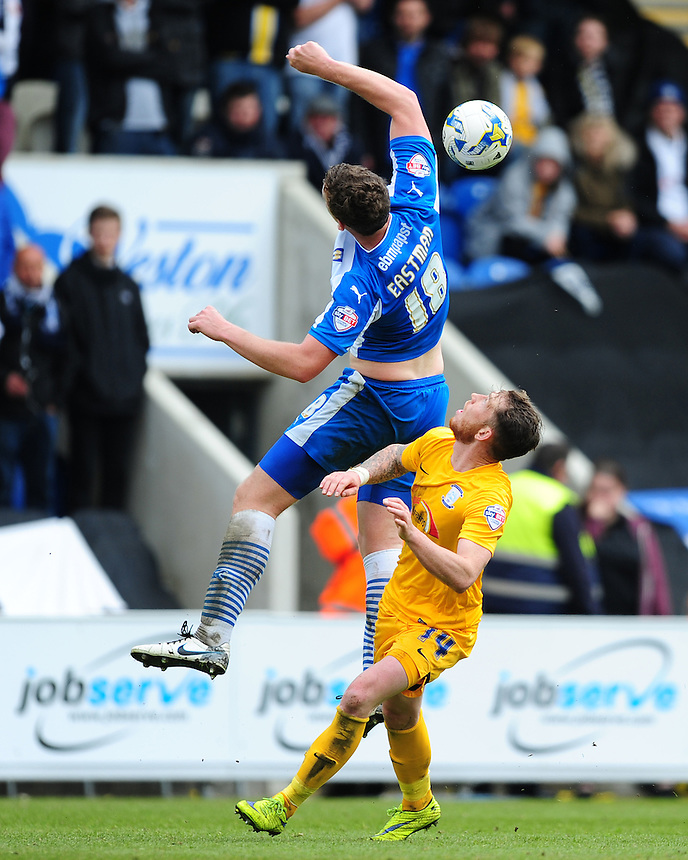 Colchester United's Tom Eastman handles the ball under pressure from Preston North End's Joe Garner<br /> <br /> Photographer Chris Vaughan/CameraSport<br /> <br /> Football - The Football League Sky Bet League One - Colchester United v Preston North End - Sunday 3rd May 2015 - Weston Homes Community Stadium - Colchester<br /> <br /> &copy; CameraSport - 43 Linden Ave. Countesthorpe. Leicester. England. LE8 5PG - Tel: +44 (0) 116 277 4147 - admin@camerasport.com - www.camerasport.com