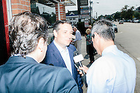 Texas senator and Republican presidential candidate Ted Cruz speaks to a television reporter before business round-table at the Draft Sports Bar and Grille in Concord, New Hampshire.