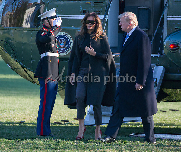 United States President Donald J. Trump and First Lady Melania Trump return to the White House after attending the funeral service of Rev. Billy Graham and a Republican Fundraiser at Mar-a-Lago, Florida. Photo Credit: Chris Kleponis/CNP/AdMedia