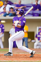 Kirk Cunningham #41 of the LSU Tigers follows through on his swing against the Wake Forest Demon Deacons at Alex Box Stadium on February 20, 2011 in Baton Rouge, Louisiana.  The Tigers defeated the Demon Deacons 9-1.  Photo by Brian Westerholt / Four Seam Images