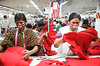 Female workers checking the products at a garments factory in Gazipur, near Dhaka, Bangladesh