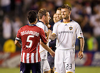 LA Galaxy midfielder David Beckham and Chivas USA midfielder Paulo Nagamura make amends after the match. The LA Galaxy defeated Chivas USA 1-0 to win the final edition of the 2009 SuperClásico at Home Depot Center stadium in Carson, California on Saturday, August 29, 2009...