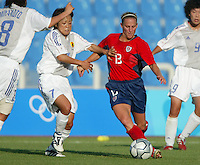 20 August 2004:   Kristine Lilly dribbles the ball away from Japan defender during the quarterfinals at Kaftanzoglio Stadium in Thessaloniki, Greece.     USA defeated Japan, 2-1 .   Credit: Michael Pimentel / ISI