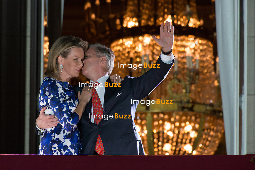 BRUSSELS, BELGIUM:  King Philippe Of Belgium and Queen Mathilde Of Belgium greet the people on the balcony of the Royal Palace before the fireworks. King Philippe addresses his fa nocturnal speech to to the public.. July 21, 2013