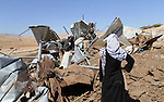 A Palestinian man stands on the debris of his possessions after it was destroyed allegedly by Israeli army tractors on Sep. 16, 2013 in the West Bank of desolate Makhoul in east of Tubas city. The house was located in the so-called Area C, a closed military zone where Israel exercises full control and was built without permission, according to the Israeli army. Photo by Nedal Eshtayah