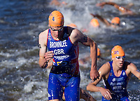 20 JUL 2013 - HAMBURG, GER - Jonathan Brownlee  (GBR) of Great Britain heads for transition at the end of the swim at the elite men's ITU 2013 World Triathlon Series round in the Altstadt Quarter, Hamburg, Germany (PHOTO COPYRIGHT © 2013 NIGEL FARROW, ALL RIGHTS RESERVED)