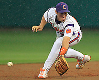Clemson's Jason Stolz misfields a groundball hit by Miami's Peter O'Brien as rain begins to fall in the third inning at Doug Kingsmore Stadium on Friday.