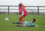 Paul Johnson puts in a sliding tackle on Lifford's Lunga Balman. Photograph by Declan Monaghan