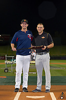 Chris Paul (21), of the Surprise Saguaros is presented with the Zinger Bats First Place Award Bat by Jake Hirschman after winning the American League bracket in the Arizona Fall League Bowman Hitting Challenge on October 21, 2017 at Sloan Park in Mesa, Arizona. Chris Paul, of the Minnesota Twins organization, won the American League trophy while Tomas Nido (not shown) won the National League trophy. (Zachary Lucy/Four Seam Images)