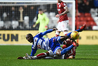 Korey Smith of Bristol City challenges Sone Aluko of Reading during the Sky Bet Championship match between Bristol City and Reading at Ashton Gate, Bristol, England on 26 December 2017. Photo by Paul Paxford.