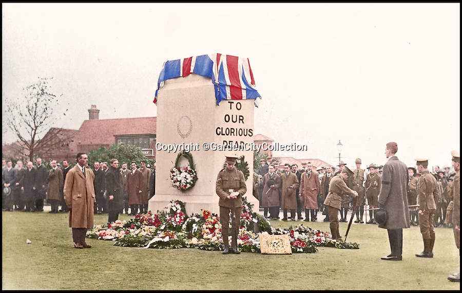BNPS.co.uk (01202 558833)<br /> Pic: GardenCityCollection/BNPS<br /> <br /> ***Please USe Full Byline***<br /> <br /> The first Armistice Day parade in Letchworth Garden City c.1920. <br /> <br /> Black and white photos of British Tommies preparing for the First World War have been brought to life after they were digitally colourised to mark the 100th anniversary of the start of the conflict.<br /> <br /> Some of the snaps show soldiers in vivid colour getting battle-ready at training camps in the Home Counties in July 1914.<br /> <br /> Others depict the men dressed in their smart green uniforms on parade in a market square on the eve of war and then stood on a train station platform as they head off for France.<br />  <br /> As well as being filled with colour, some of the photos are tinged with poignancy as many of the men pictured never came back.