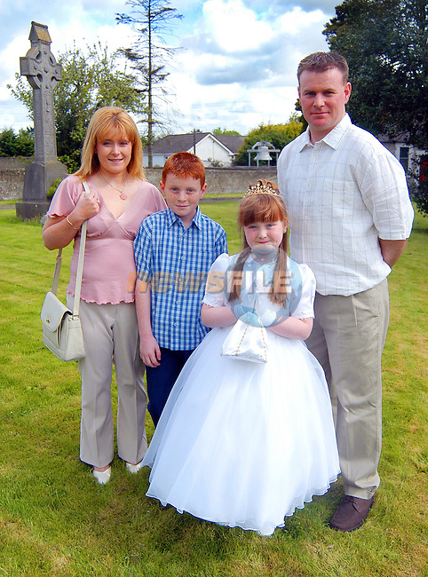 Lauren McQuaile,at her First Holy Communion in Duleek,with her parents Annmarie and Nigel, and brother Darren...Picture  Newsfile...This Picture is sent to you by:..Newsfile Ltd.The View, Millmount Abbey, Drogheda, Co Louth, Ireland..Tel: +353419871240.Fax: +353419871260.GSM: +353862500958.ISDN: +353419871010.email: pictures@newsfile.ie.www.newsfile.ie