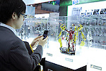 February 7, 2013, Tokyo, Japan - A visitor takes a picture of the figure action of Iron Man at TIGS in Tokyo. The 75th Tokyo International Gift Show (TIGS) is an exhibition of personal gifts, consumer goods and decorative accessories. The TIGS is the largest International Trade Show in Japan, and held semi-annually, each Spring and Autumn at Tokyo Big Sight.  The exhibition is held on February 6 to 8. (Photo by Rodrigo Reyes Marin/AFLO)..