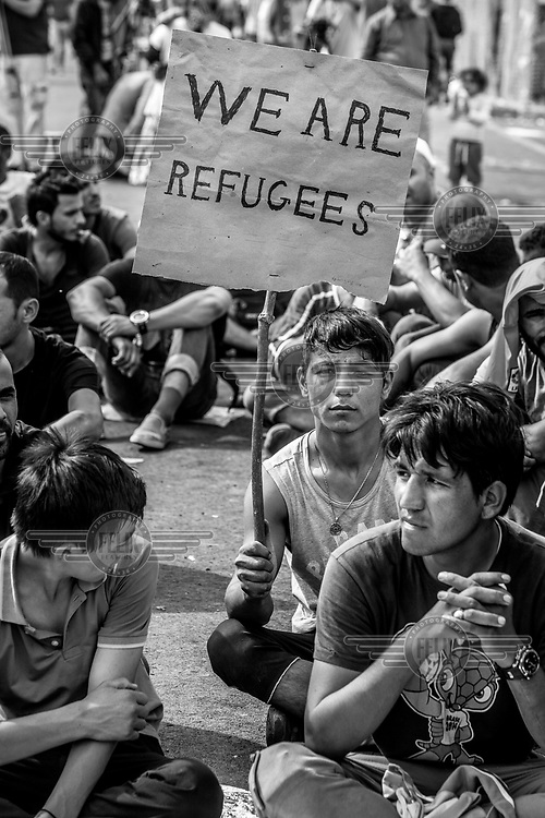 An Afghan refugee protests at the Hungarian border, closed a few days earlier.