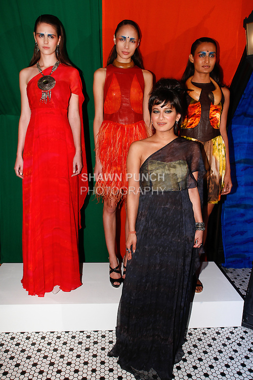 Fashion designer Sheena Trivedi poses with models during her Sheena Trivedi Spring Summer 2014 collection show, at Hotel Chantelle on October 21, 2013.