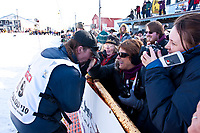 Lance Mackey greets the crowd at the finish chute after winning his 4th consecutive Iditarod in Nome, Alaska