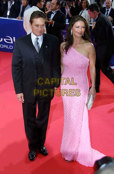 MICHAEL DOUGLAS & CATHERINE ZETA JONES.Arriving At The Last Evening of Laureus World Sports Awards To Honour The Best Athletes Of The Year.  .celebrity couple, married, black suit, red carpet, pink crochet dress, off the shoulder, full length, full-length.www.capitalpictures.com.sales@capitalpictures.com.©Kassner/face to face/Capital Pictures