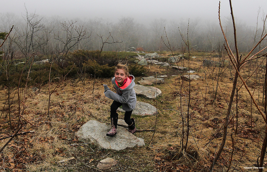 York, ME, Sunday, April 13, 2014: Rhyanne Kucinski, 7, of York runs up a trail as she hunts for treasure during the Trail Treasure Search and Aggie Easter Egg Hunt for youngsters on top of Mount Agamenticus. Portsmouth Herald Photo Cheryl Senter