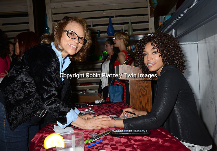 """a fan and Tia Dionne Hodge-Jones, who was on One Life to Live, at her book signing party on May 29, 2014 at Tryp by Wyndham Times Square South in New York City, New York, USA. The Book is called """"Play. Speak. Modern Monologues for the Modern Young Actor""""."""